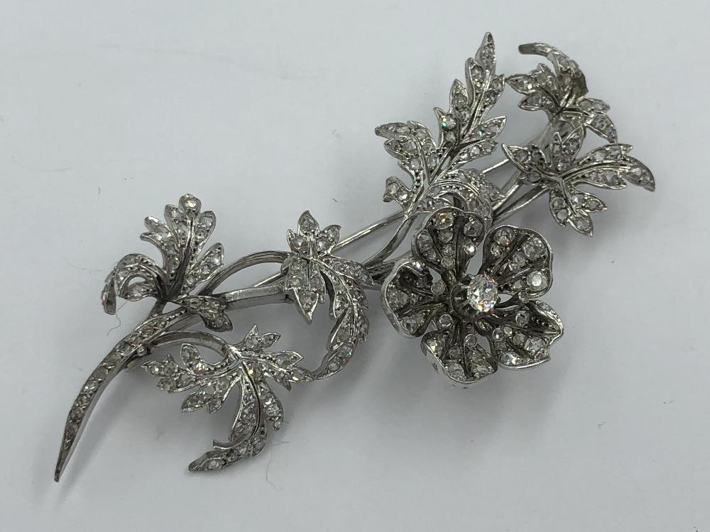 Lot 16 - NO ONLINE BIDDING LOTS 1-30. Late C19/20th (early) white metal & diamond spray brooch
