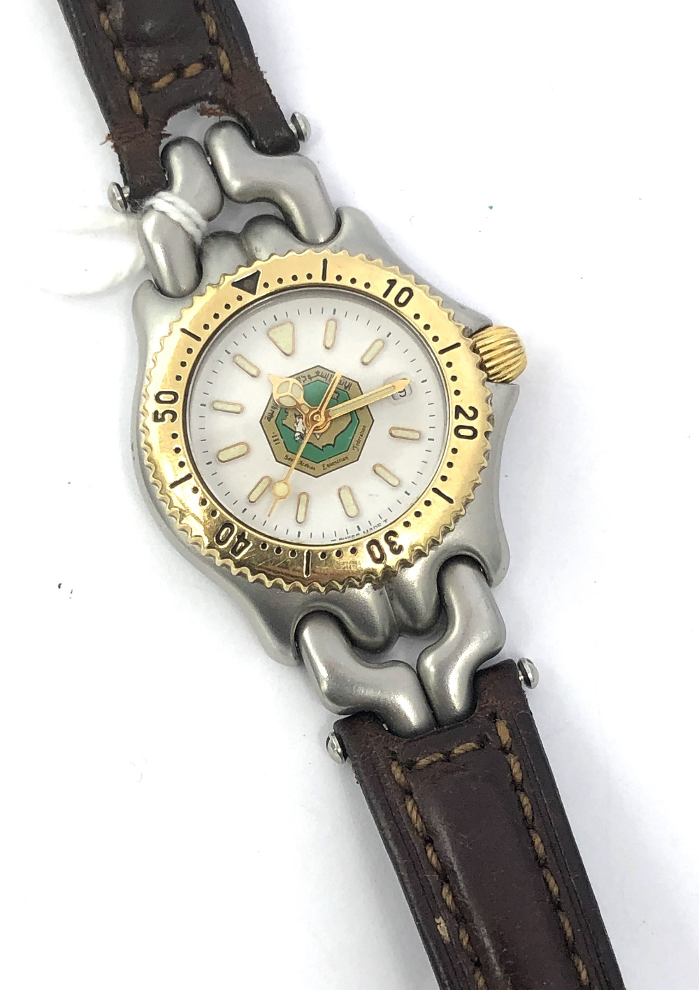 Lot 40 - Ladies Tag Heuer stainless steel & yellow metal wristwatch with white dial with gold batons, central