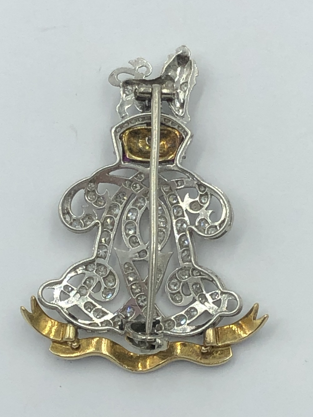 Lot 8 - NO ONLINE BIDDING LOTS 1-30. Unmarked white & yellow metal Life Guards Regimental style badge