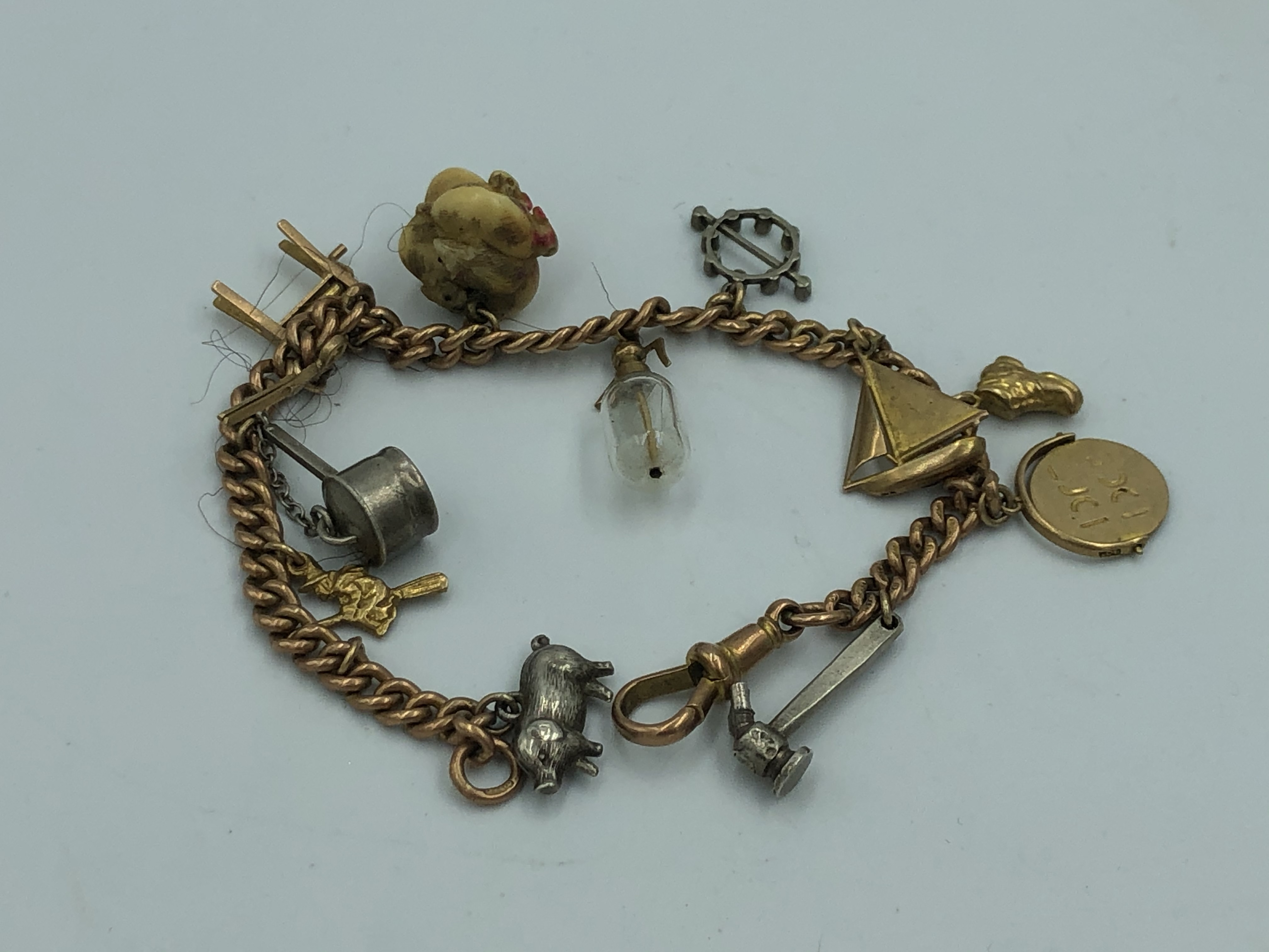 Lot 5 - NO ONLINE BIDDING LOTS 1-30. 9ct gold churb link charm bracelet with 12 charms (some 9ct gold)