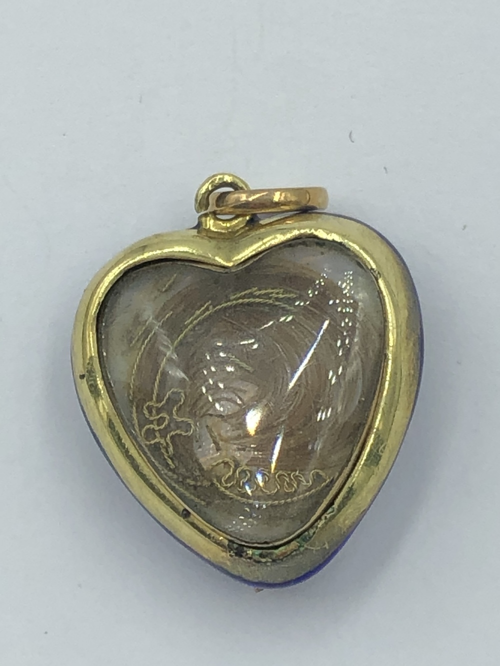 Lot 19 - NO ONLINE BIDDING LOTS 1-30. Heart shaped mourning pendant, blue guilloche enamel front set
