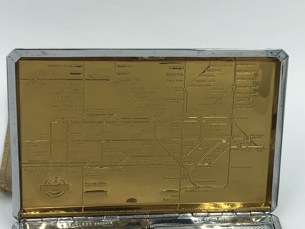 Lot 45 - C20th white metal double cigarette or card case with inset yellow metal map of 'London Underground'