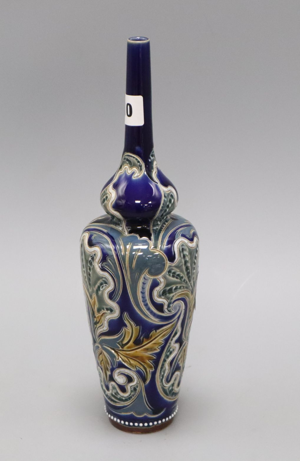 Lot 1010 - A Doulton Lambeth tall slender bottle vase, by Edith D Lupton, no. 966 with incised shell and