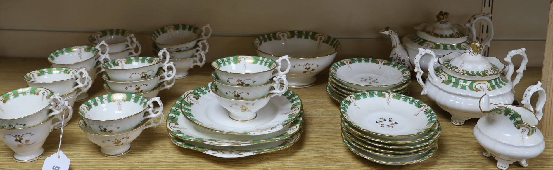 Lot 1216 - A 19th century Staffordshire gilt and green decorated teaset