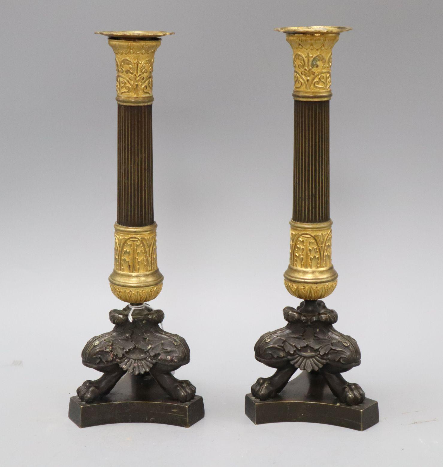 Lot 1098 - A pair of French Second Empire bronze and ormolu pillar candlesticks, H 29cm H.29.5cm