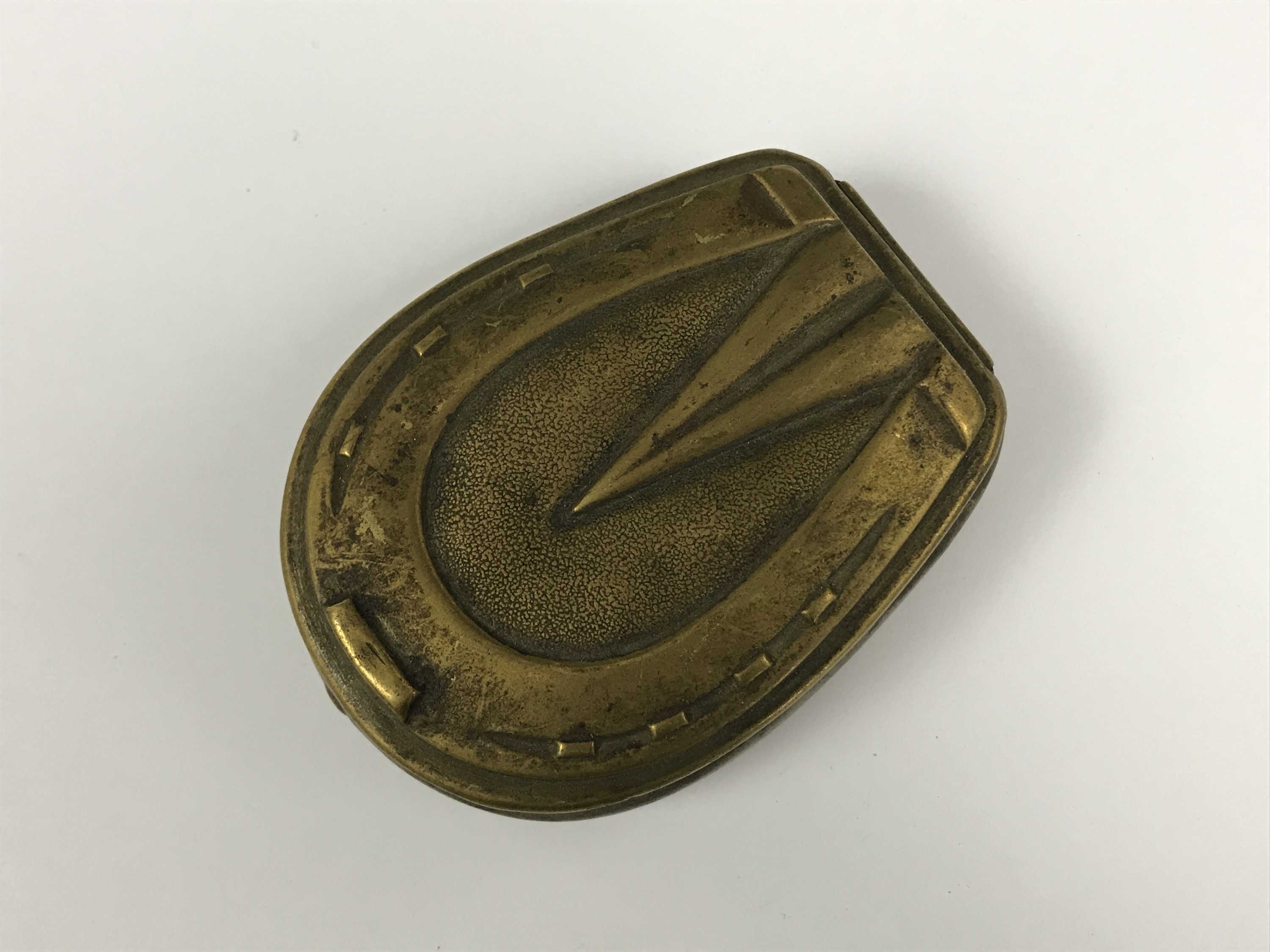 Lot 25 - A Victorian brass pocket snuff box, the hinged lid modelled as a horses hoof / shoe