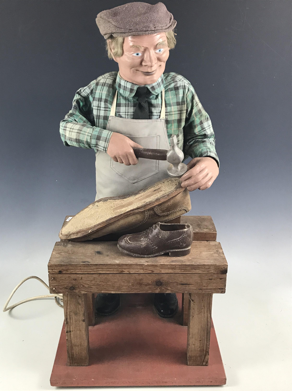 Lot 7B - A 1960s cobbler's shop window automaton advertising figure, 80 cm