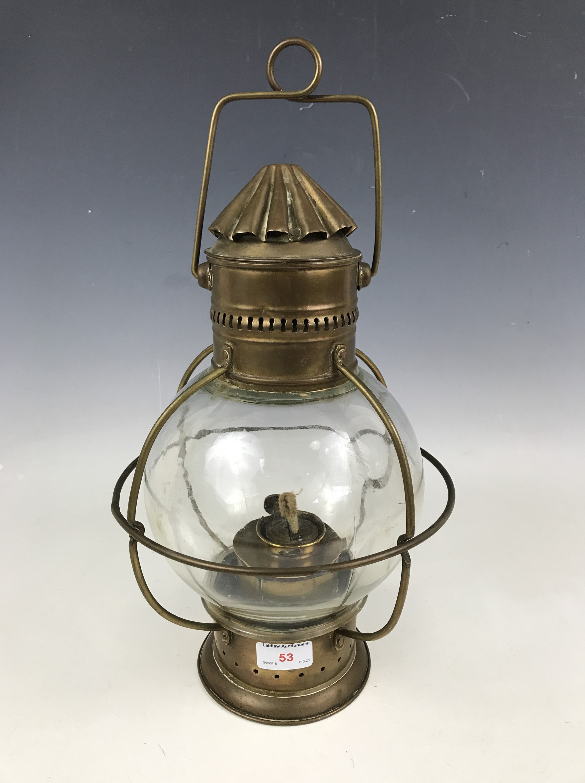 Lot 53 - A ship's brass pendant masthead oil lamp