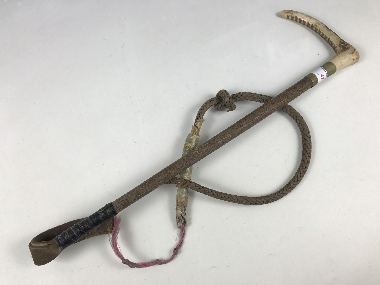 Lot 47 - An antler-handled riding whip