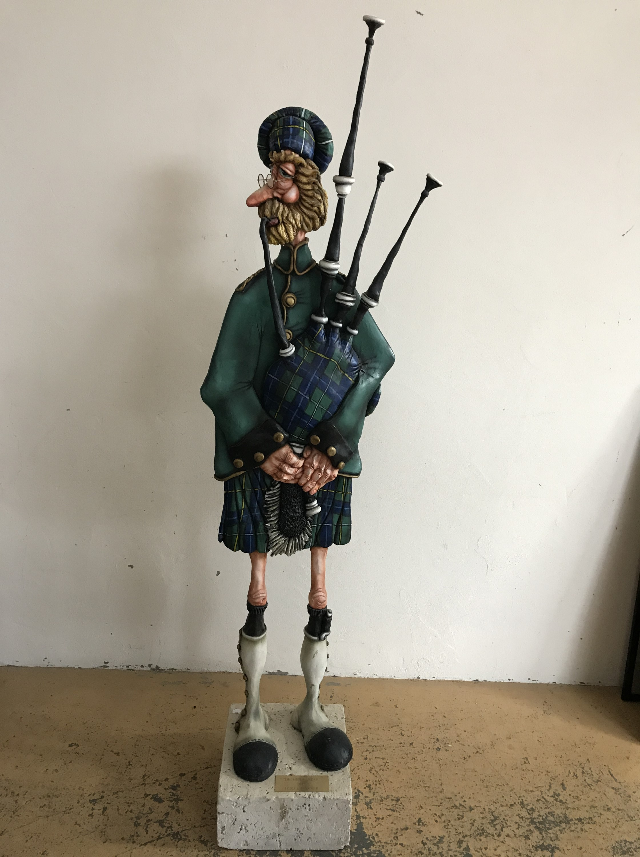 Lot 7A - Todd J. Warner (American, b.1948) A contemporary sculpture of a piper, modelled in an upright and