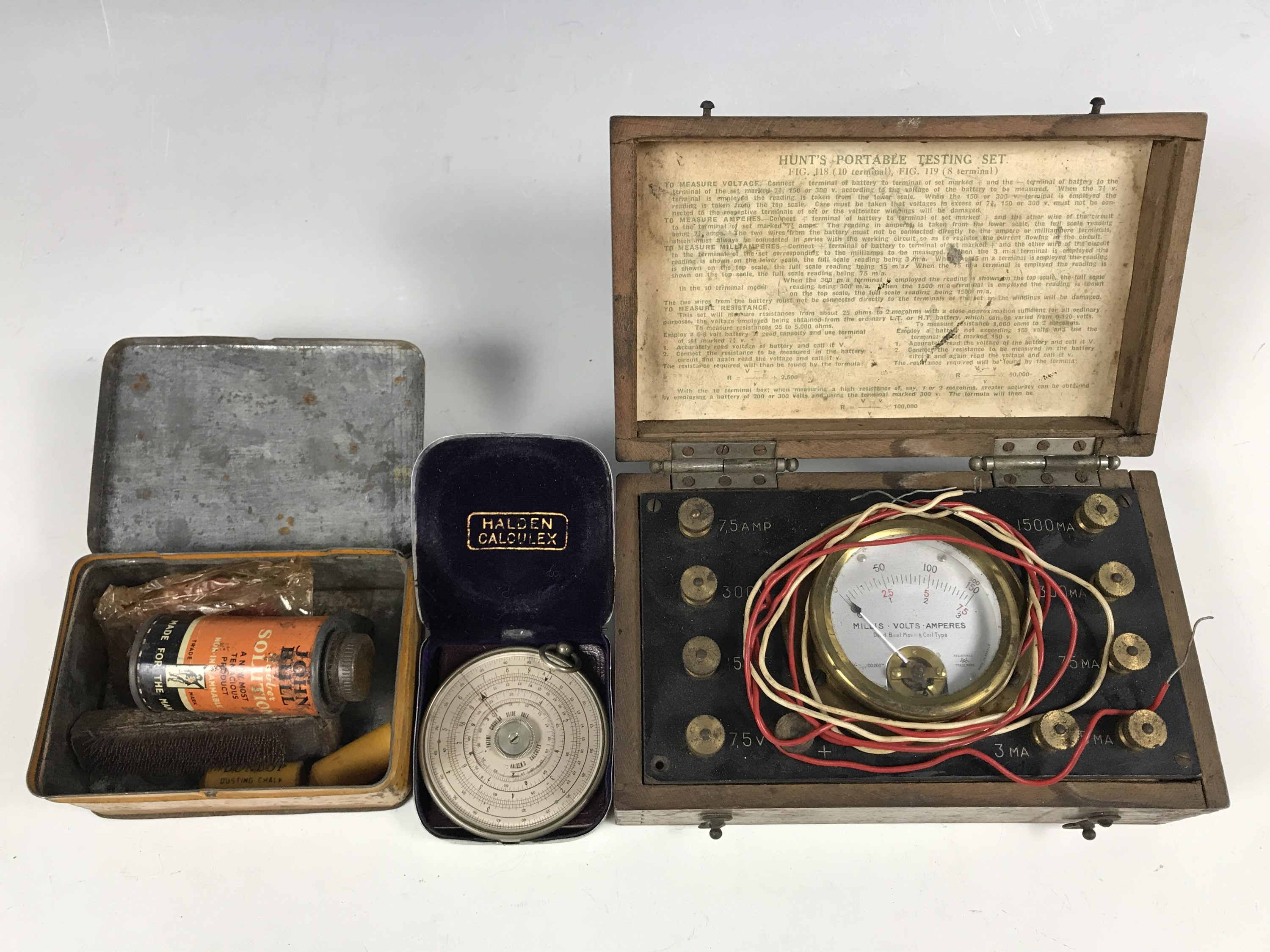 Lot 22 - A Halden Calculex circular slide rule together with a Hunt's portable electrical testing set and a