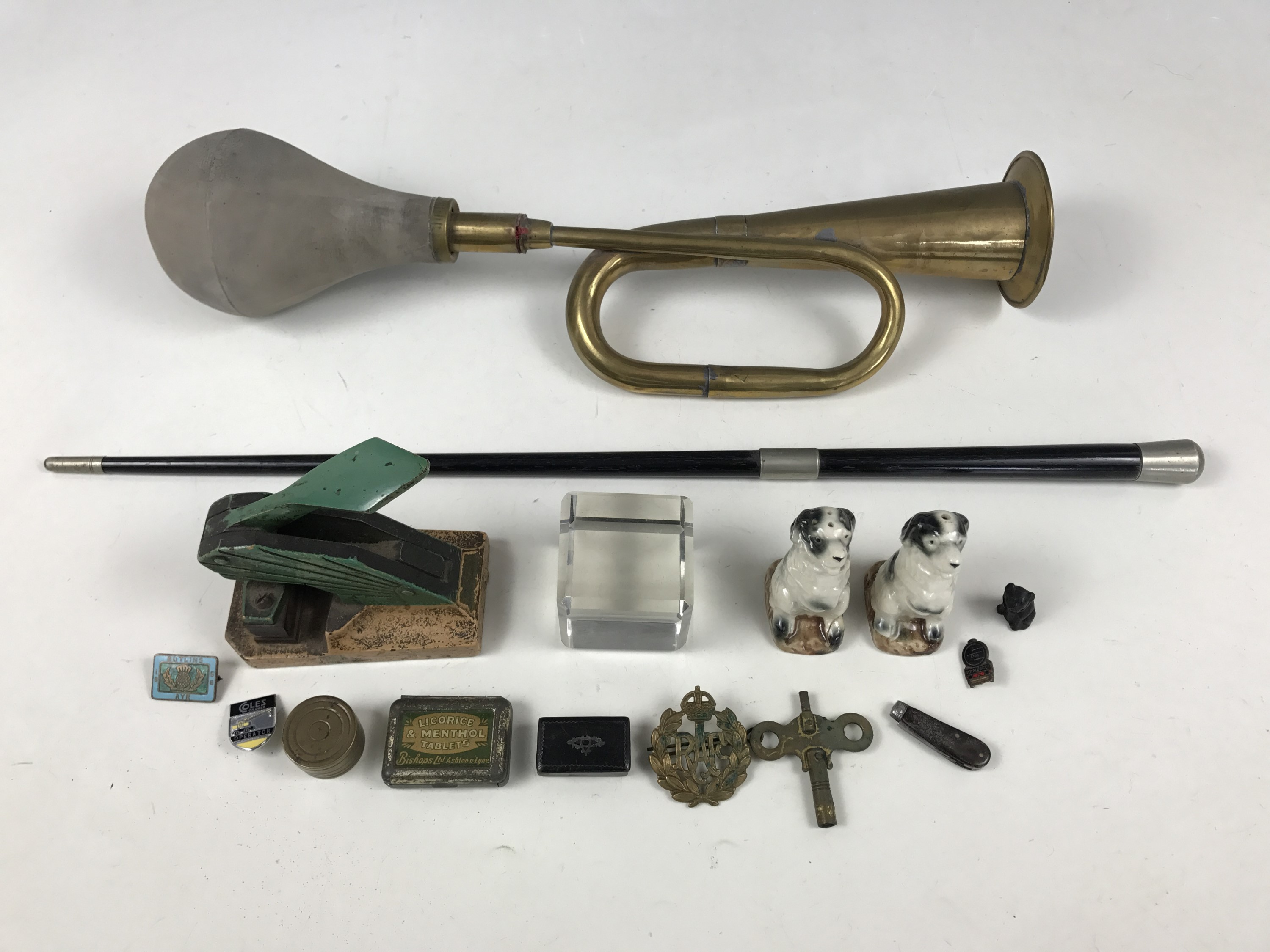 Lot 4 - Sundry collectors' items including a conductor's baton, Butlins and other badges and a 19th