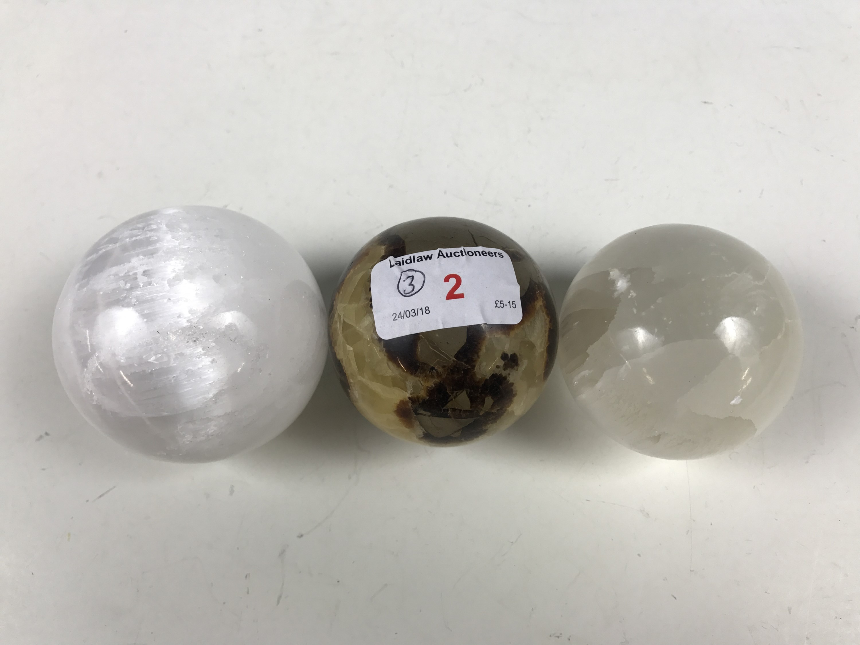 Lot 2 - Three polished mineral spheres