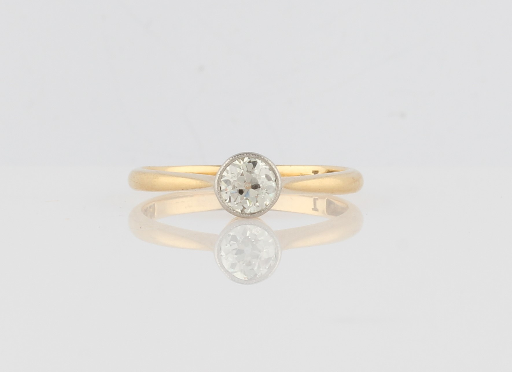 Lot 30 - A diamond solitaire ring, bezel set with an Old European cut diamond, measuring approx. 0.40ct,