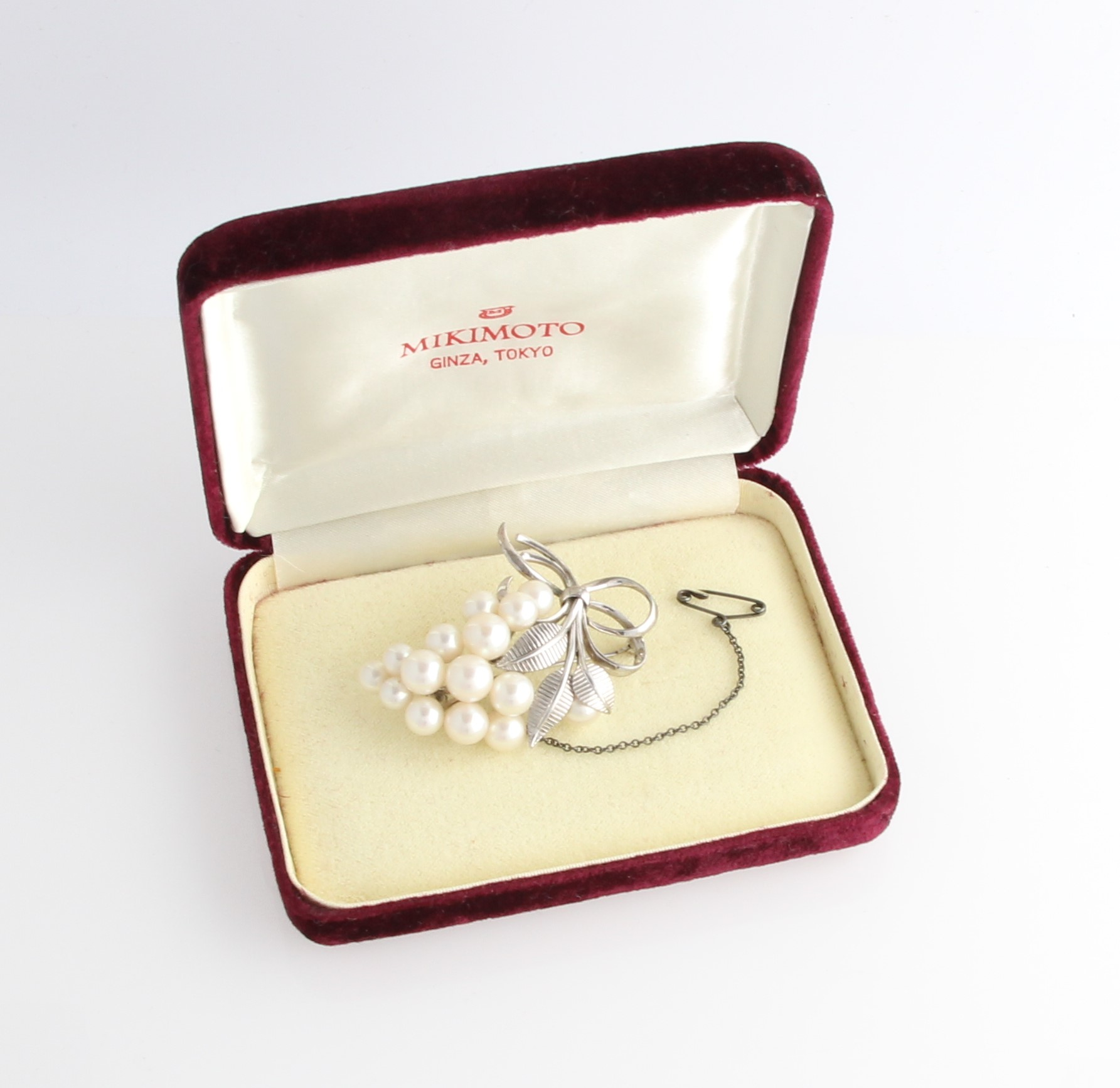 Lot 20 - A Mikimoto pearl brooch, set with fifteen variously sized pearls, smallest measuring approx. 5.5mm
