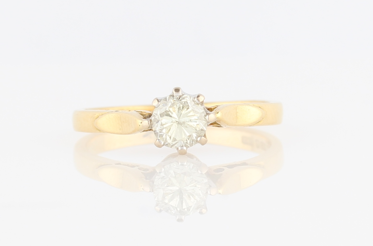 Lot 12 - An 18ct yellow gold diamond solitaire ring, set with a round brilliant cut diamond, measuring