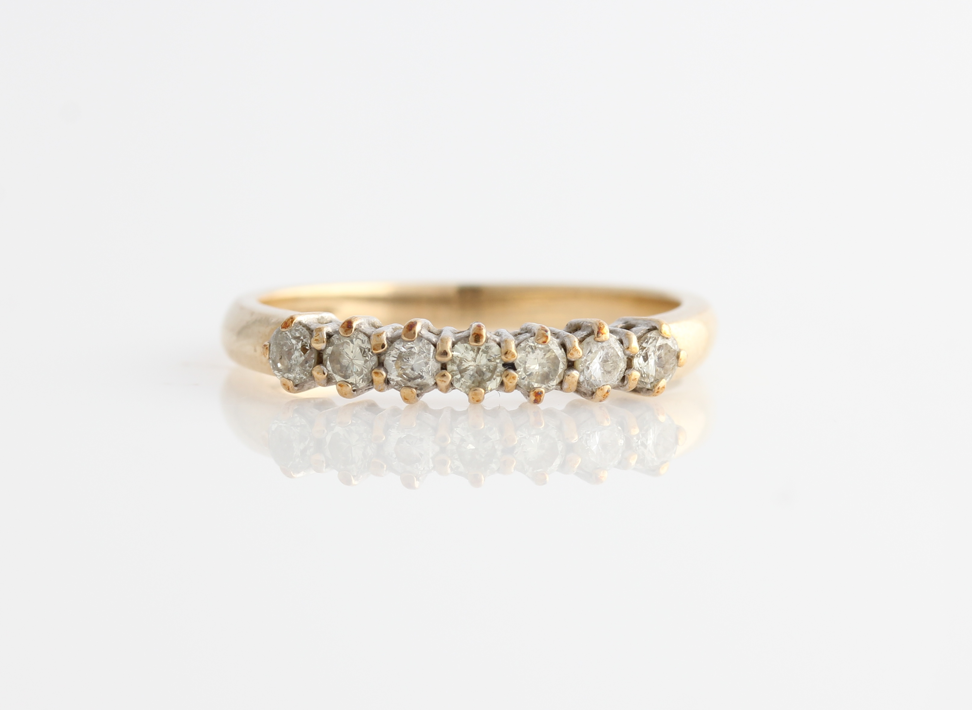 Lot 52 - A hallmarked 9ct yellow gold half eternity ring, set with seven round brilliant cut diamonds,