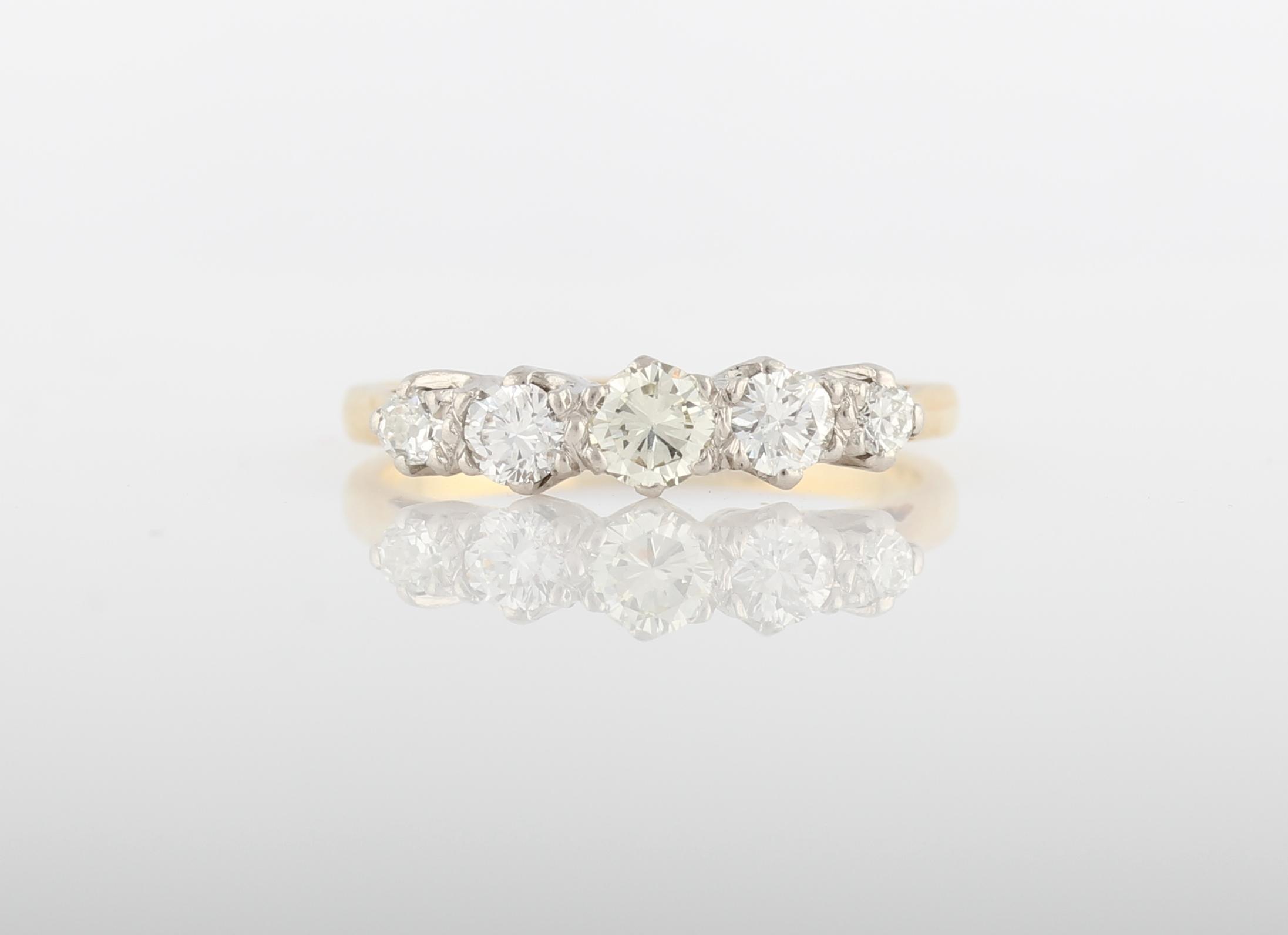 Lot 4 - A five stone diamond ring, set with five graduated round brilliant cut diamonds, total diamond
