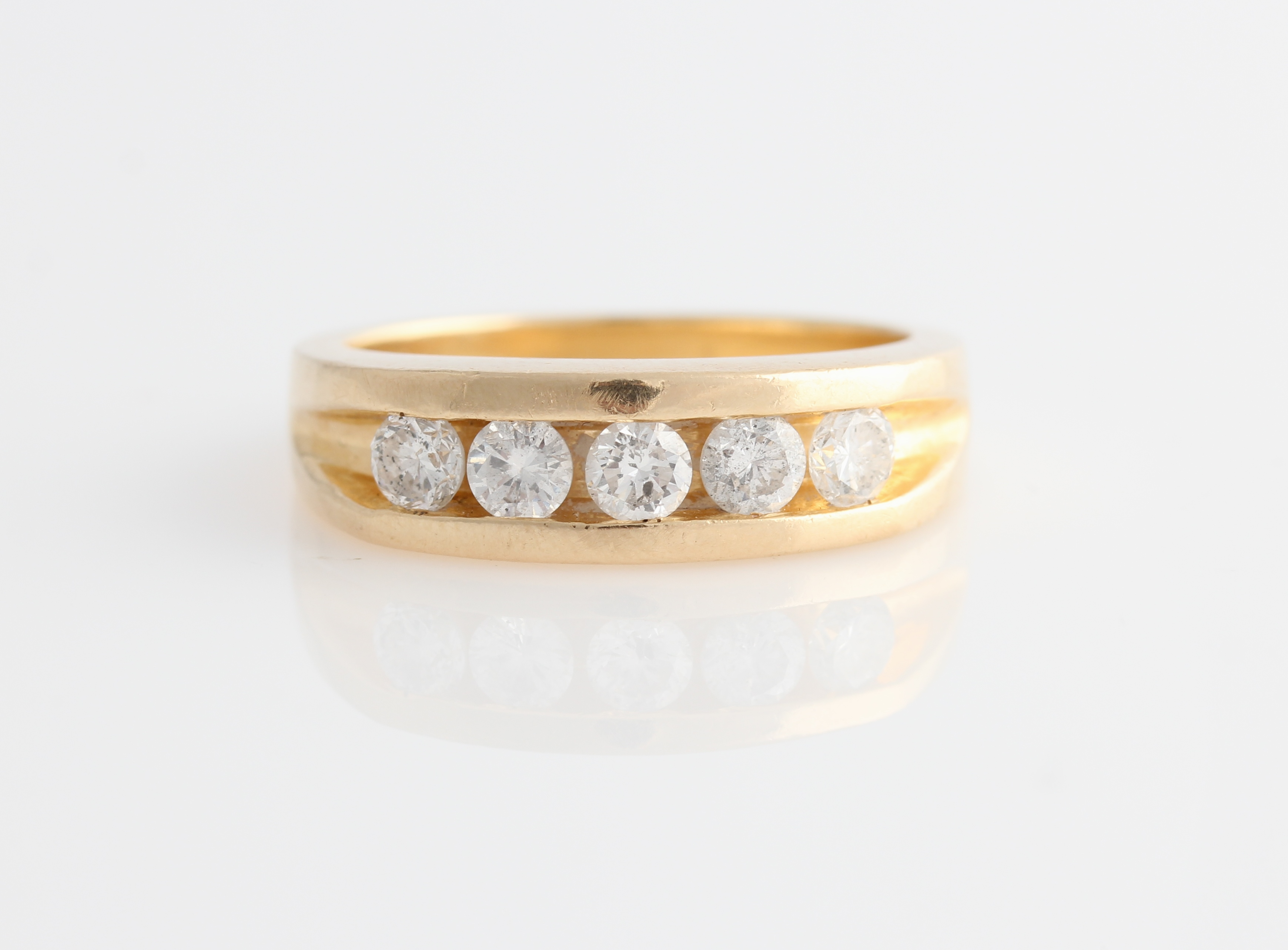 Lot 54 - A gents five stone diamond ring, set with five round brilliant cut diamonds, total diamond weight