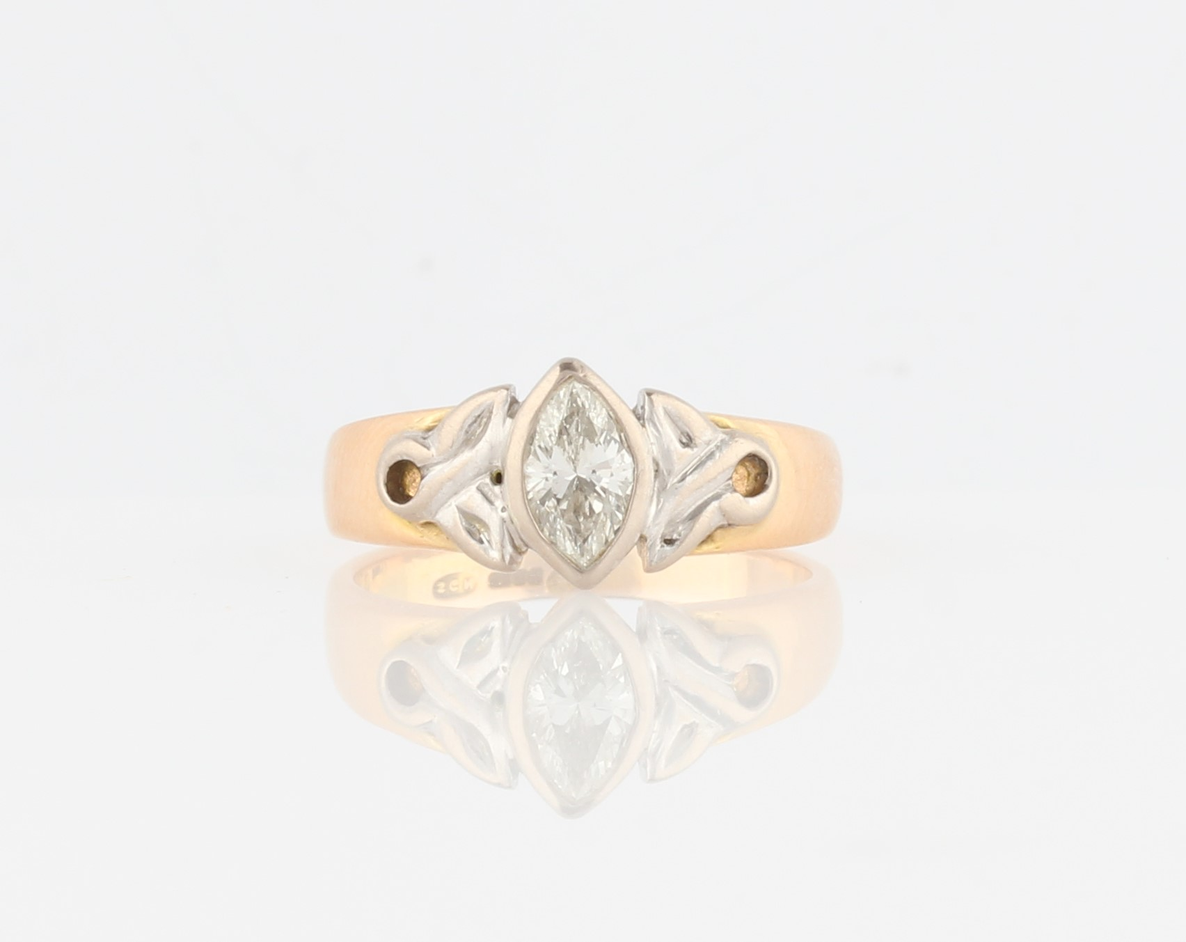 Lot 39 - A diamond solitaire ring, bezel set with a marquise cut diamond, measuring approx. 0.50ct, with