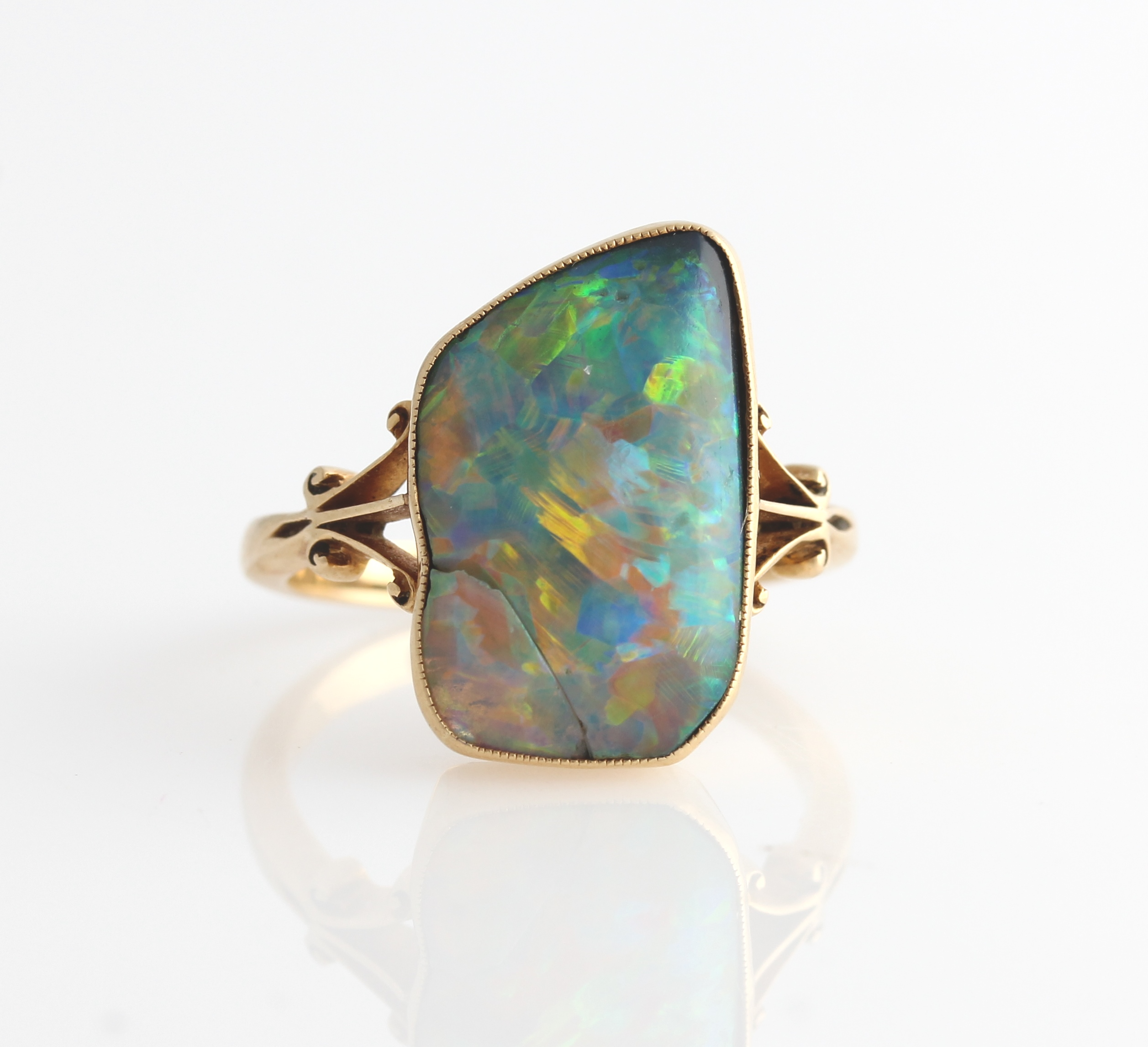 Lot 7 - An 18ct yellow old opal ring set with an irregular piece of opal, measures approx. 10x17mm, with