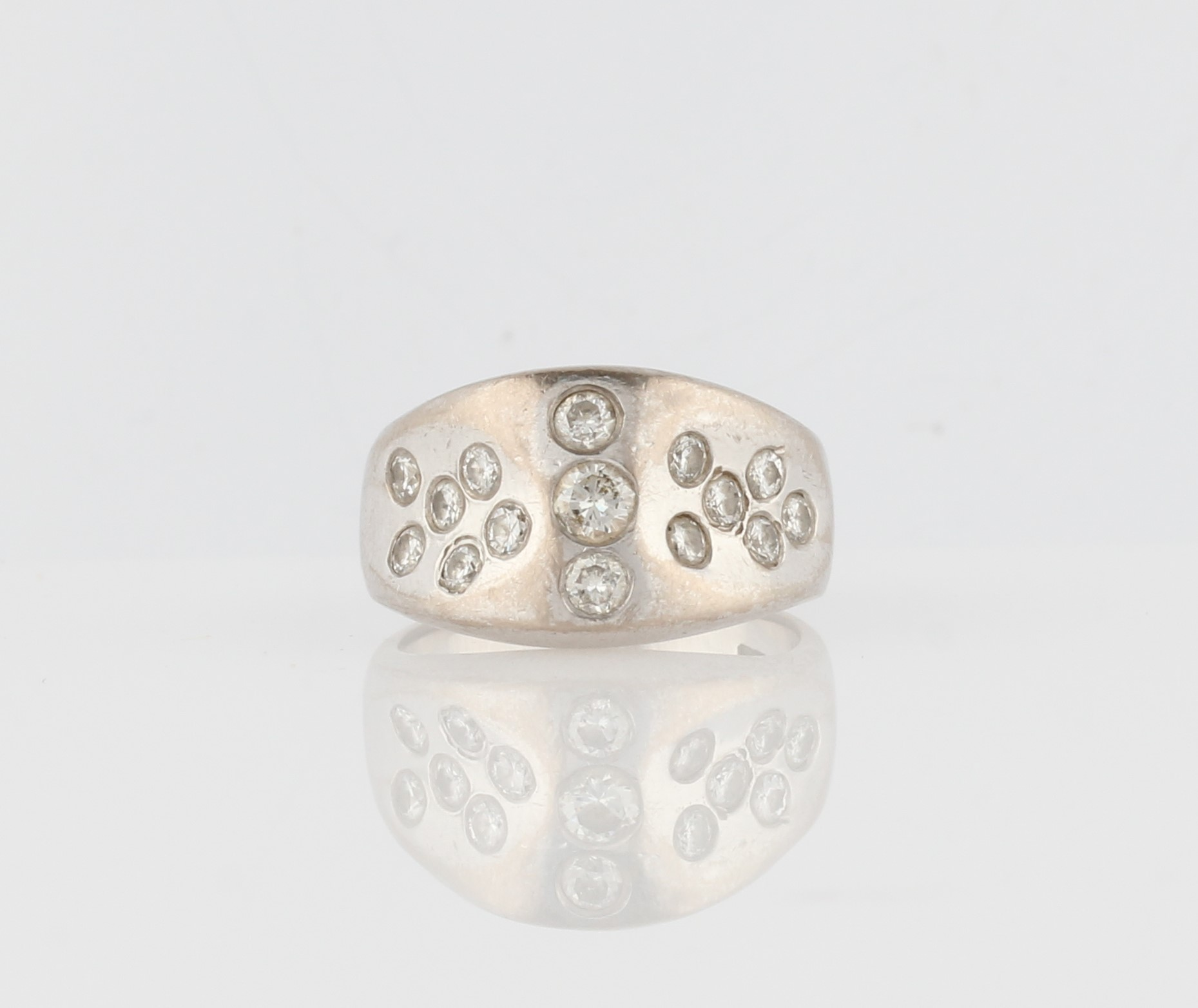 Lot 36 - A hallmarked 18ct white gold diamond ring, the shaped design scattered with variously sized