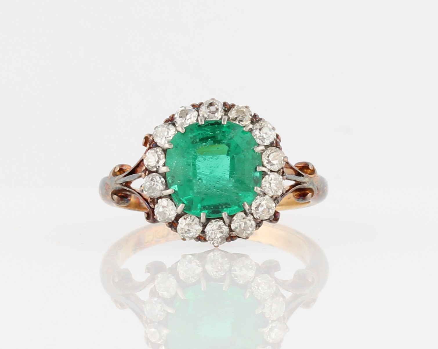 Lot 41 - An early 20th Century 18ct yellow gold green paste and diamond cluster ring, set with a cushion