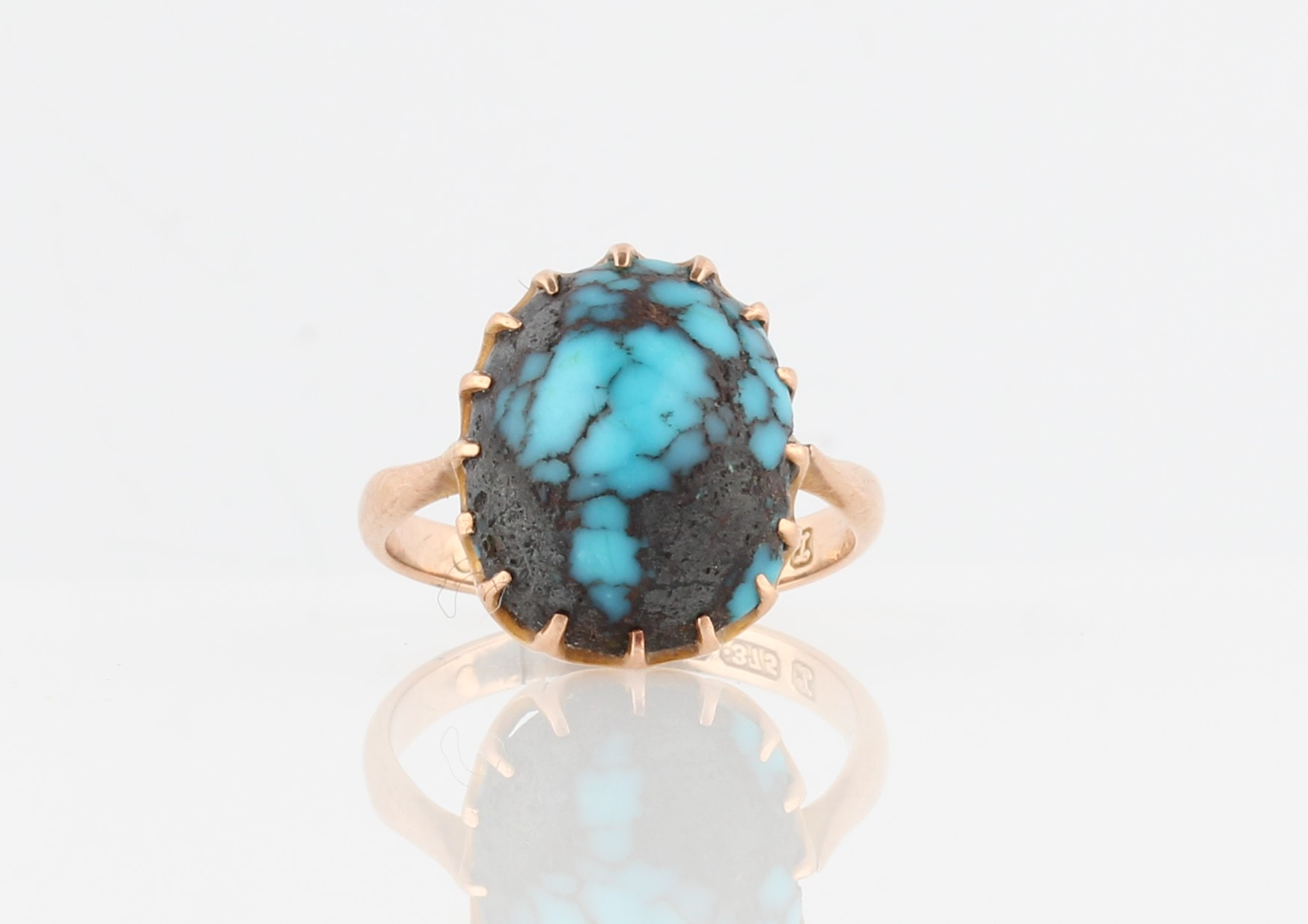 Lot 38 - A 9ct yellow gold turquoise ring, set with an oval turquoise cabochon, hallmarked Chester 1925, ring