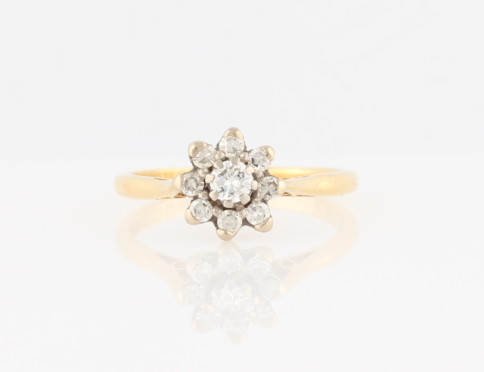 Lot 46 - An 18ct yellow gold diamond flower design ring, set with a central round brilliant cut diamond