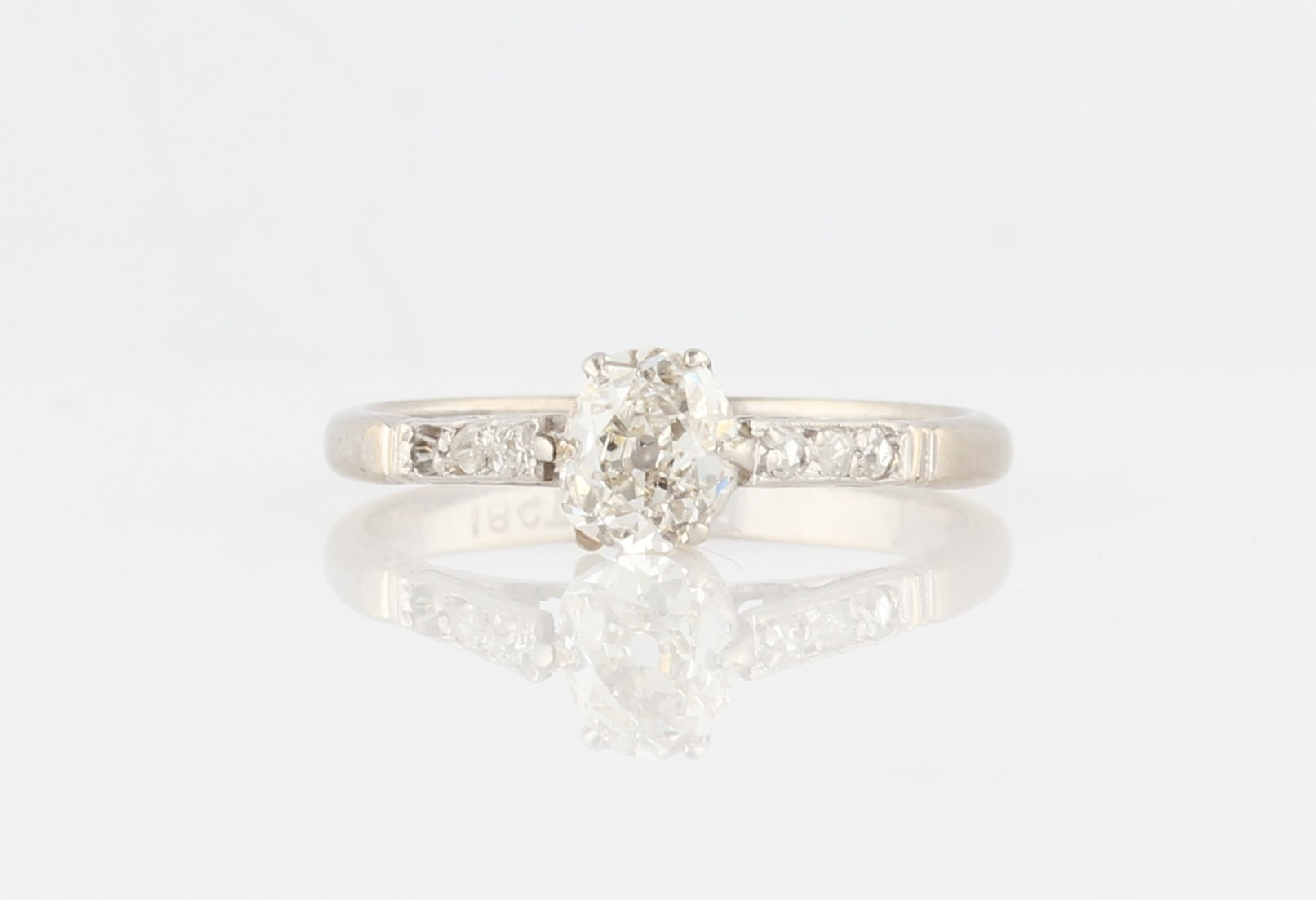 Lot 25 - A diamond ring, set with a principal old cut diamond, measuring approx. 0.50ct, with three rose