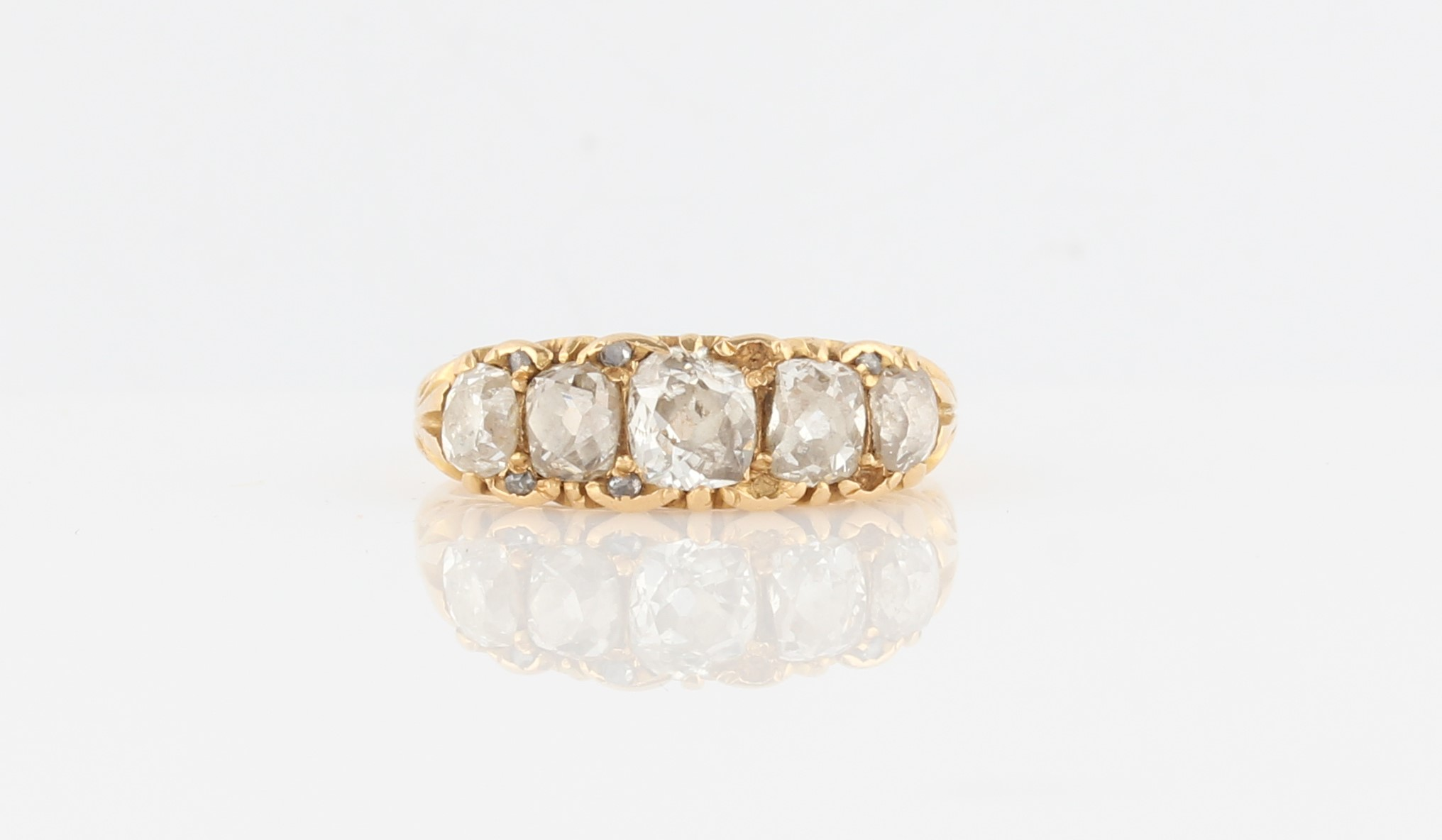 Lot 32 - A late 19th/early 20th Century diamond ring, set with five principal graduated old cut diamonds,