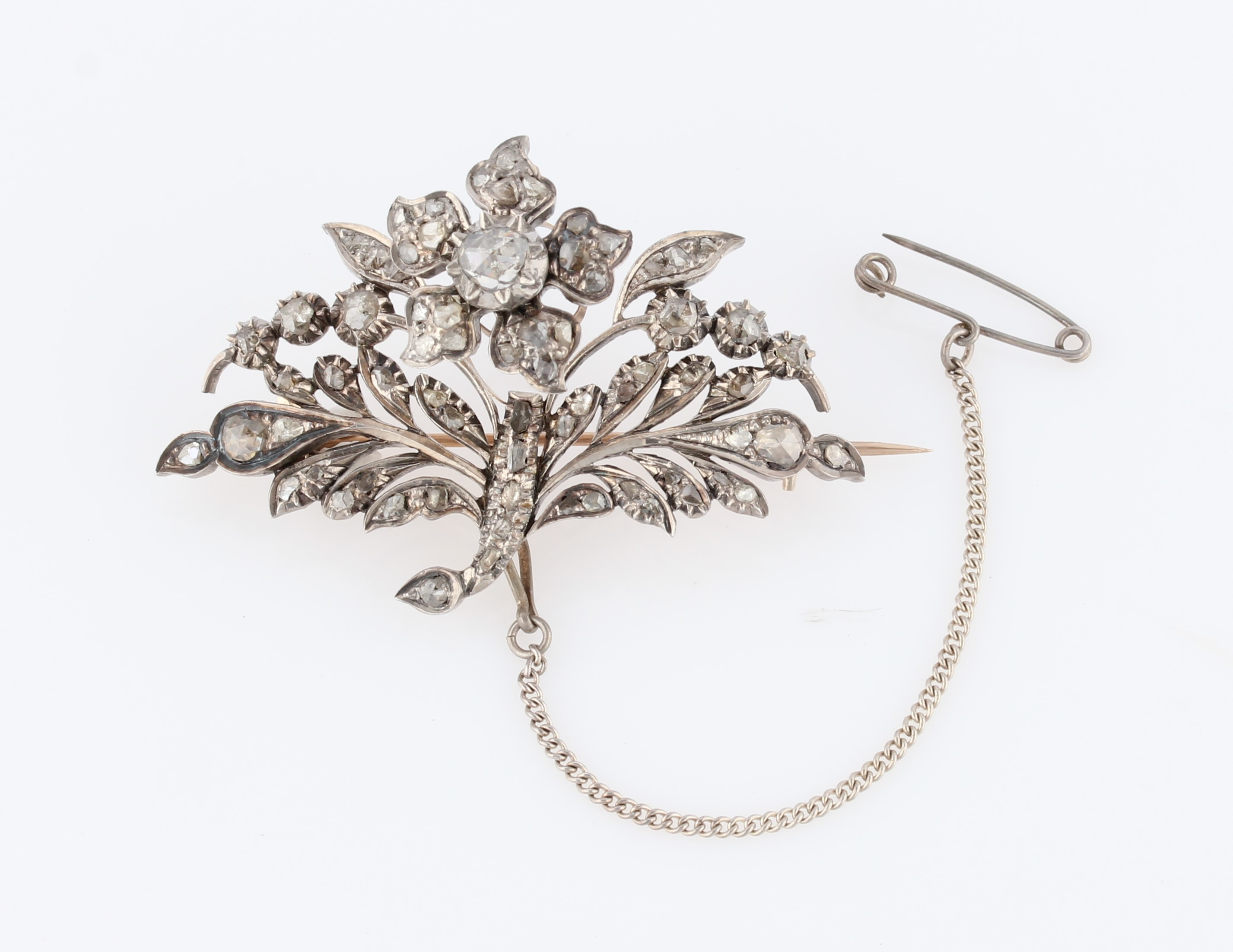 Lot 26 - An 'en tremblent' diamond set brooch, the floral and foliage design set with variously size rose cut