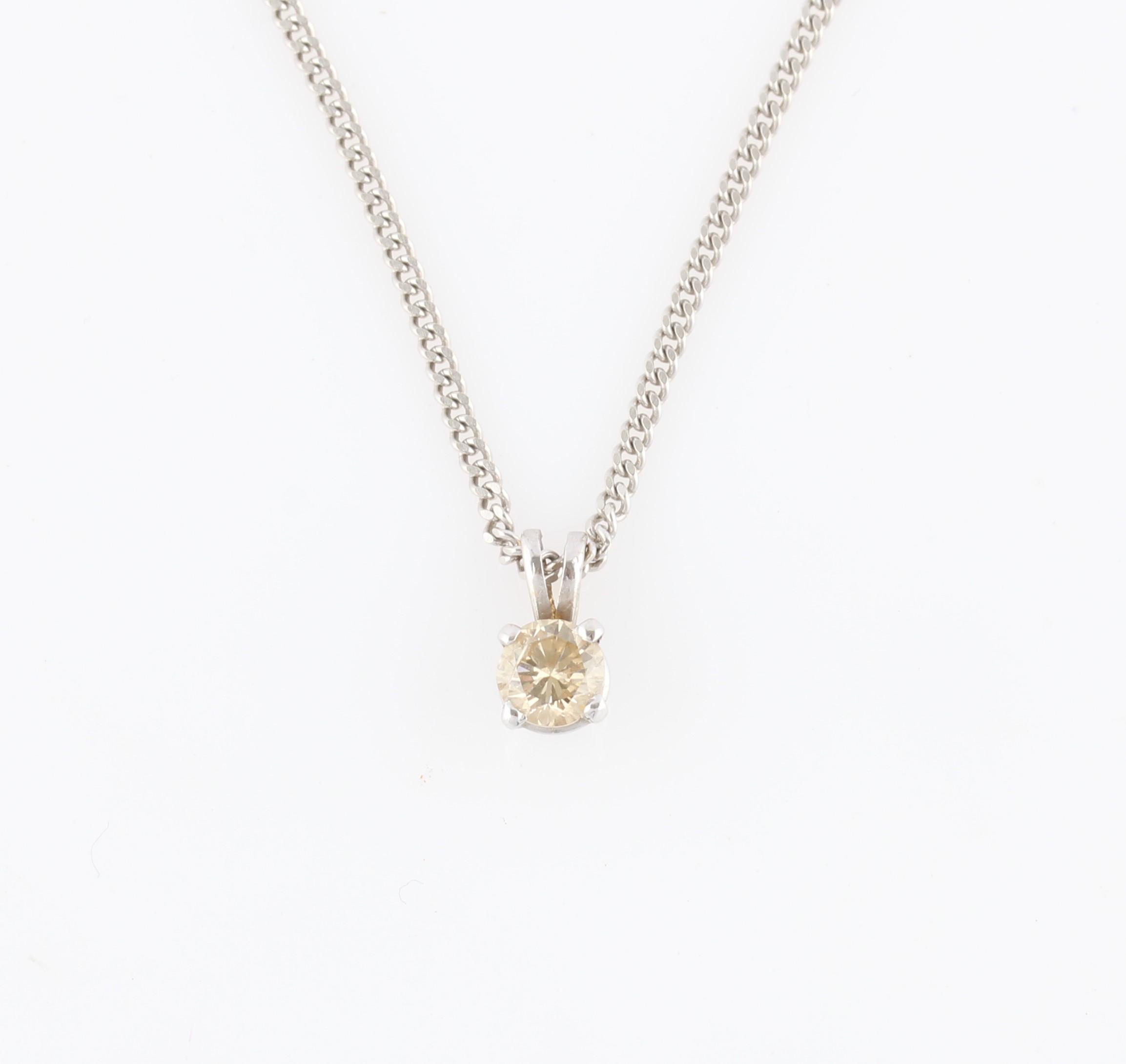 Lot 29 - A single stone diamond pendant, set with a round brilliant cut diamond, measuring approx. 0.50ct, on