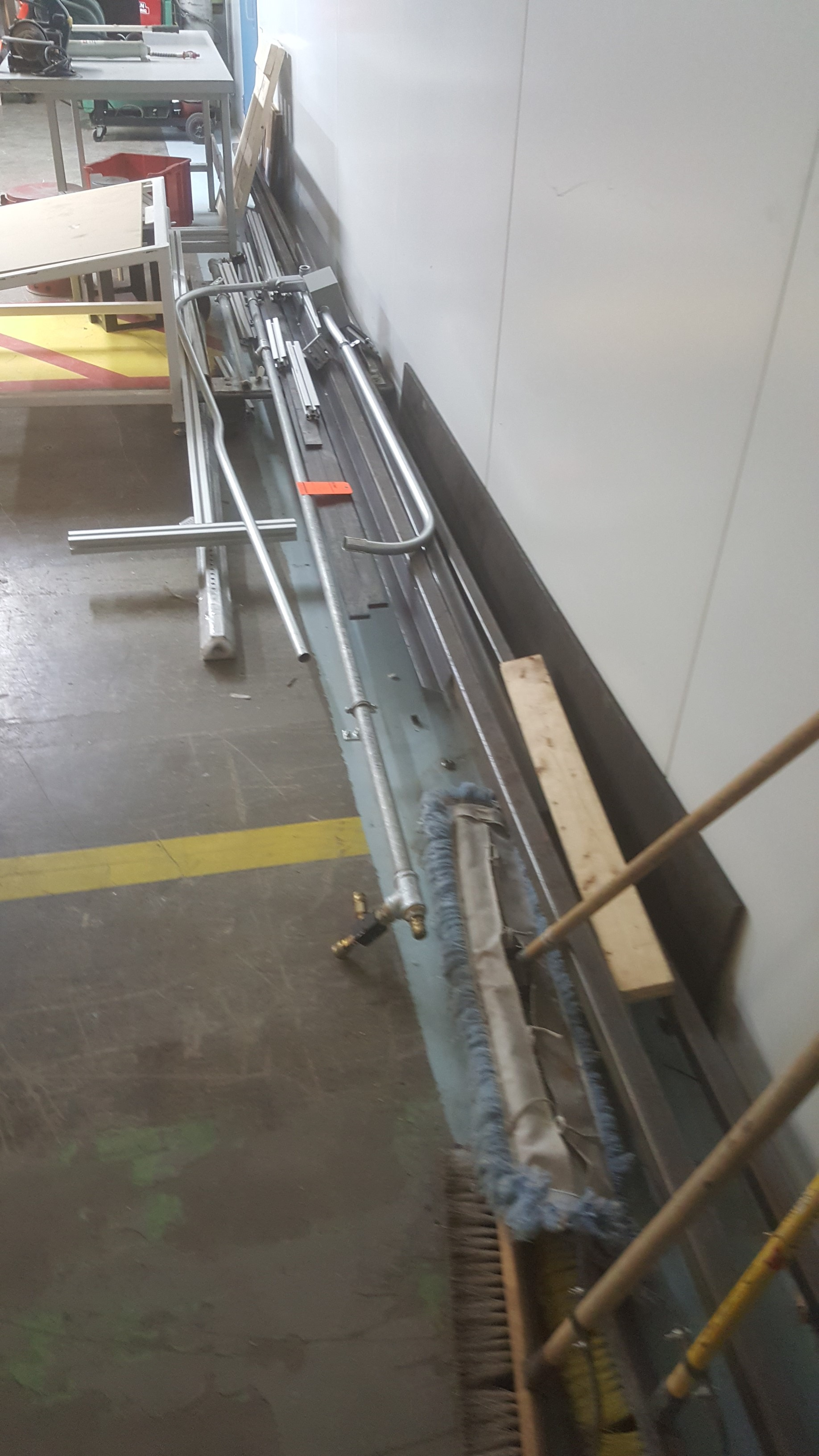 """Lot 134 - 5' x 8' steel worktable on adjustable frame w/ 1.25"""" thick steel top, various steel and aluminum"""