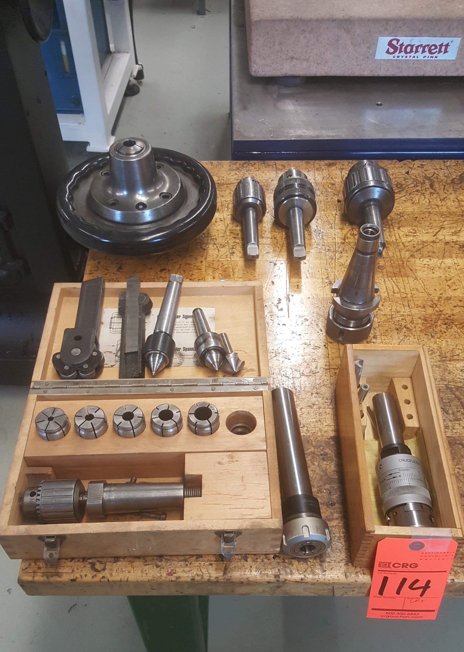 Lot 114 - Assorted bore bars, chucks, collets, centers, and related attachments