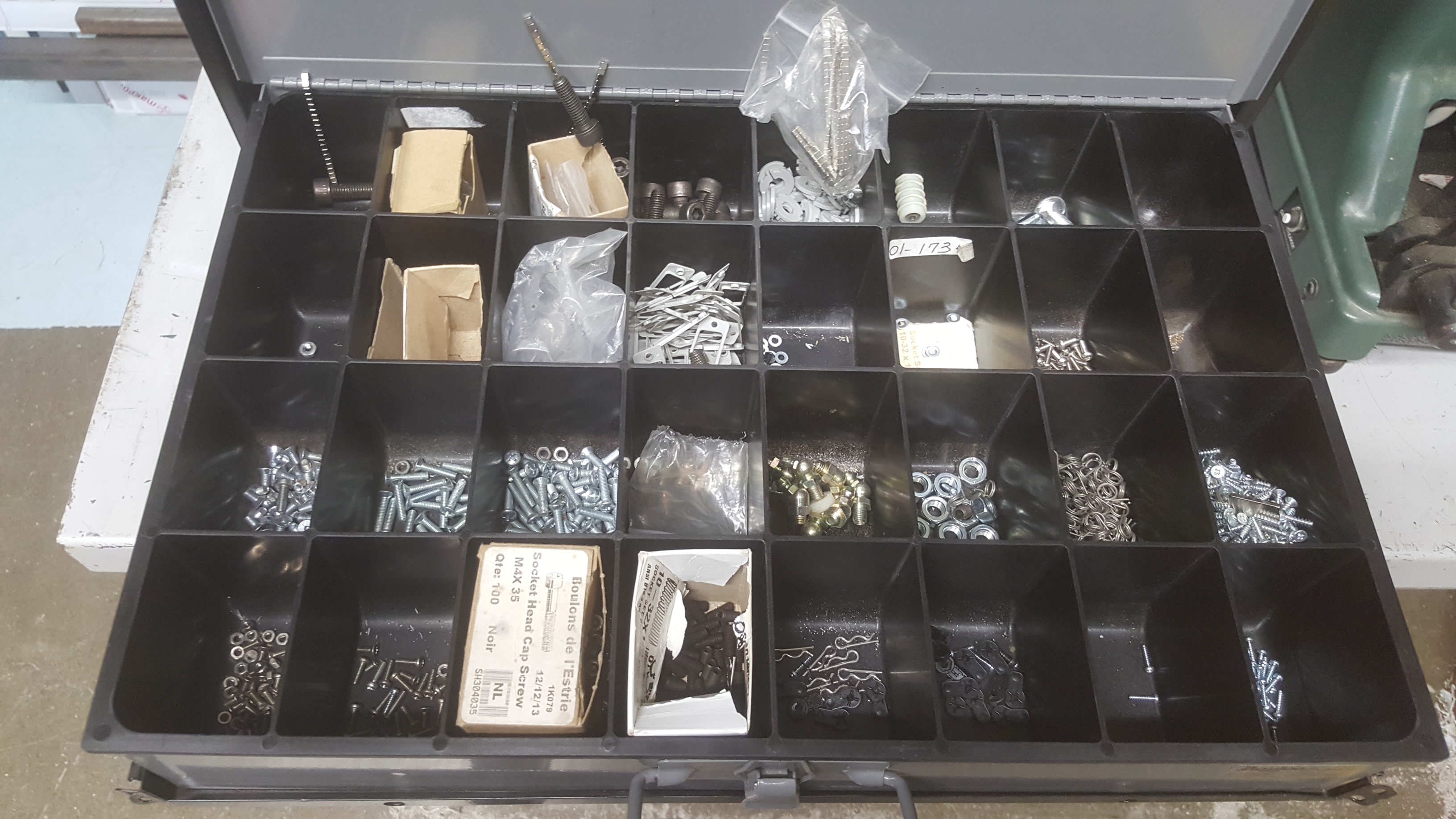 Lot 132 - Metal cabinet and contents