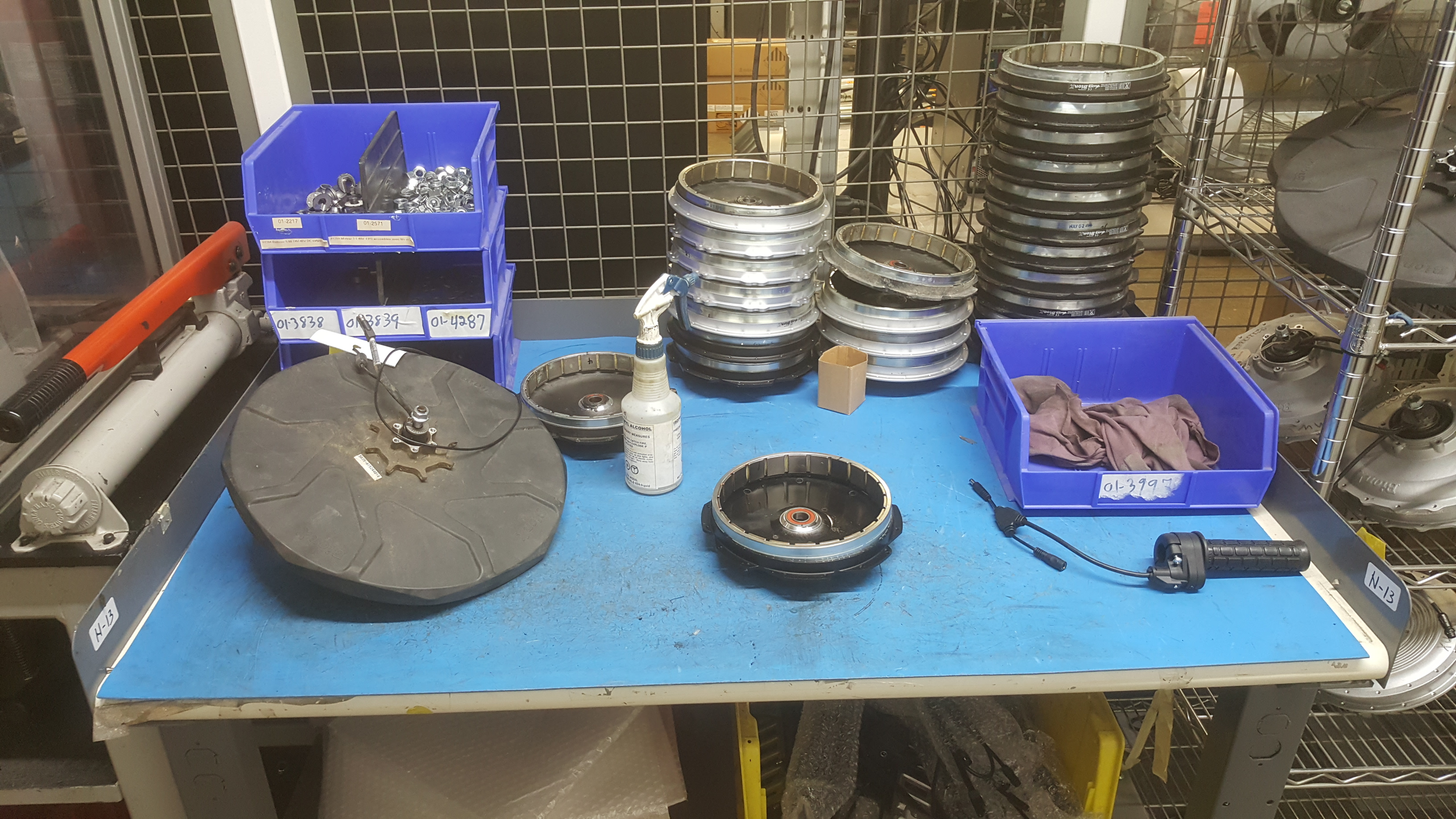 "Lot 135A - Motor, press, 48""x28"" table, racking (no bike parts/pieces)"