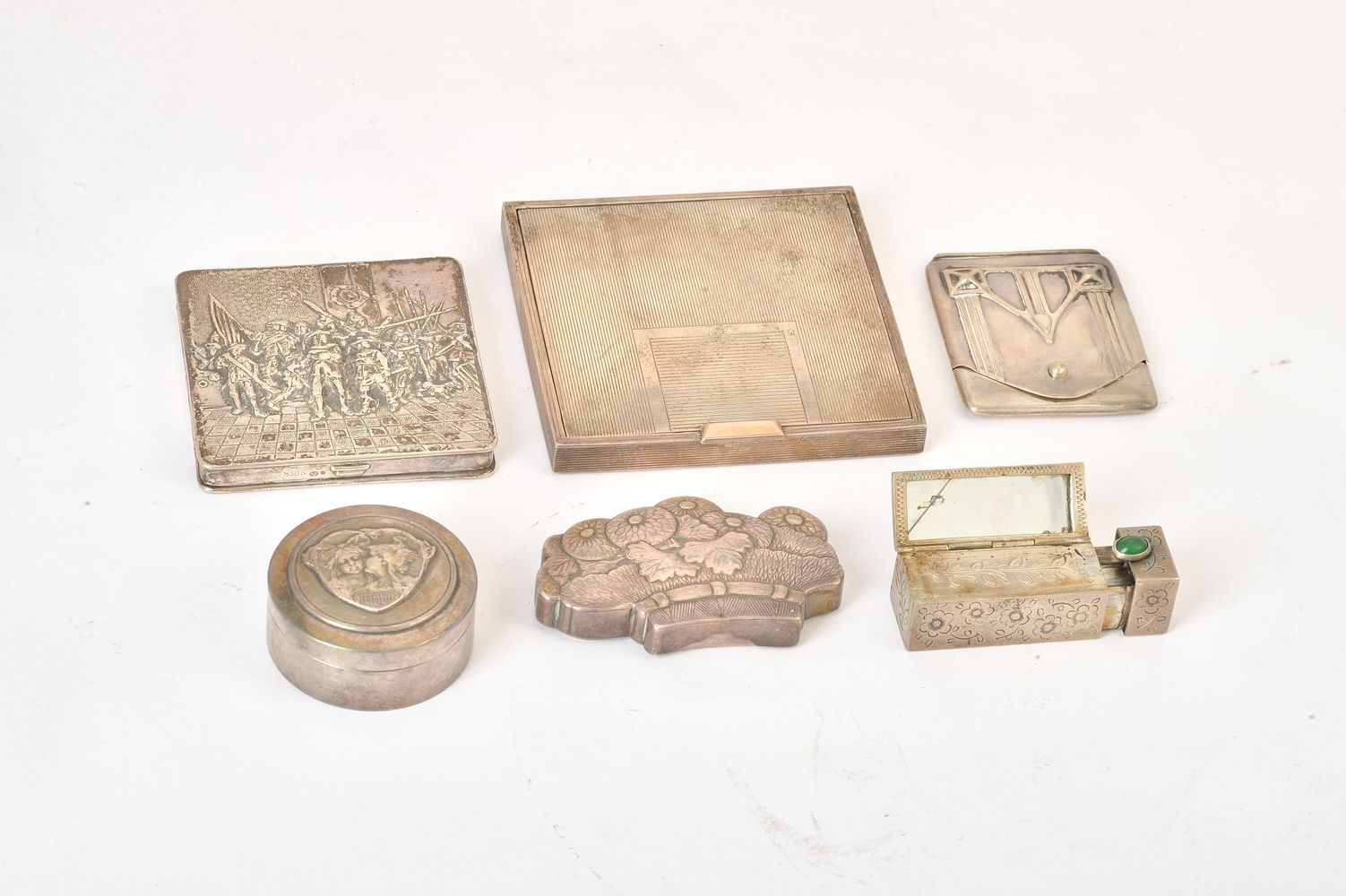 Six silver and silver coloured boxes and cases