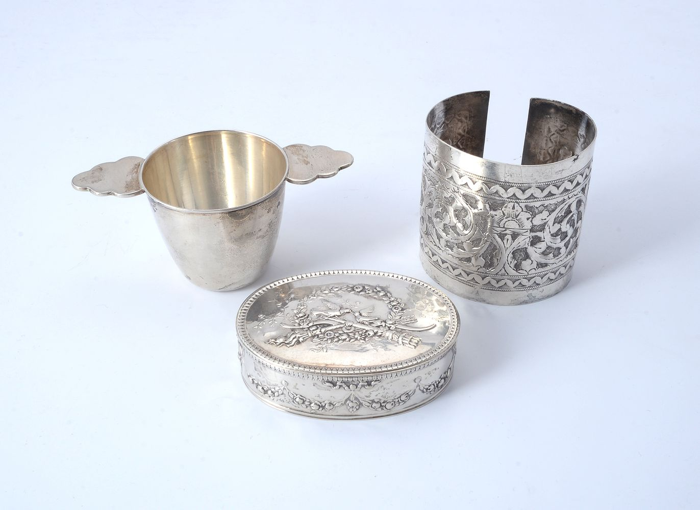 Three foreign silver coloured items