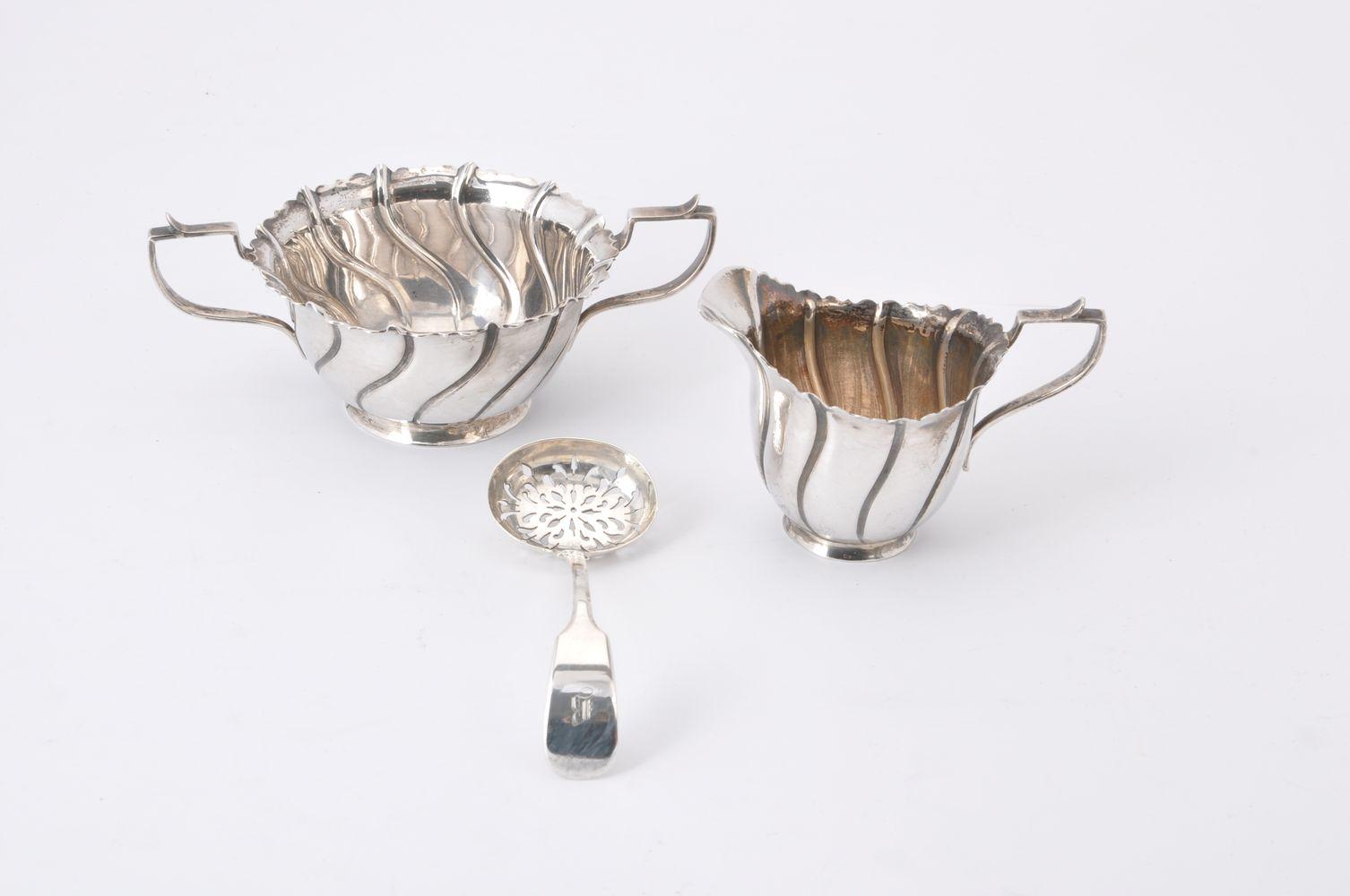 A late Victorian Irish silver sugar bowl and milk jug by The Goldsmiths & Silversmiths Co. Ltd