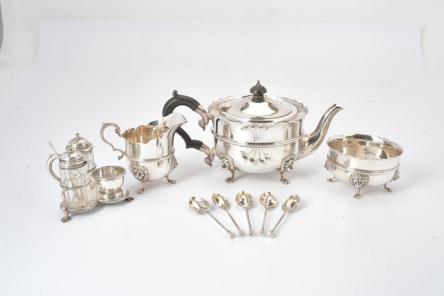 A silver shaped circular three piece tea service by Edward Barnard & Sons Ltd