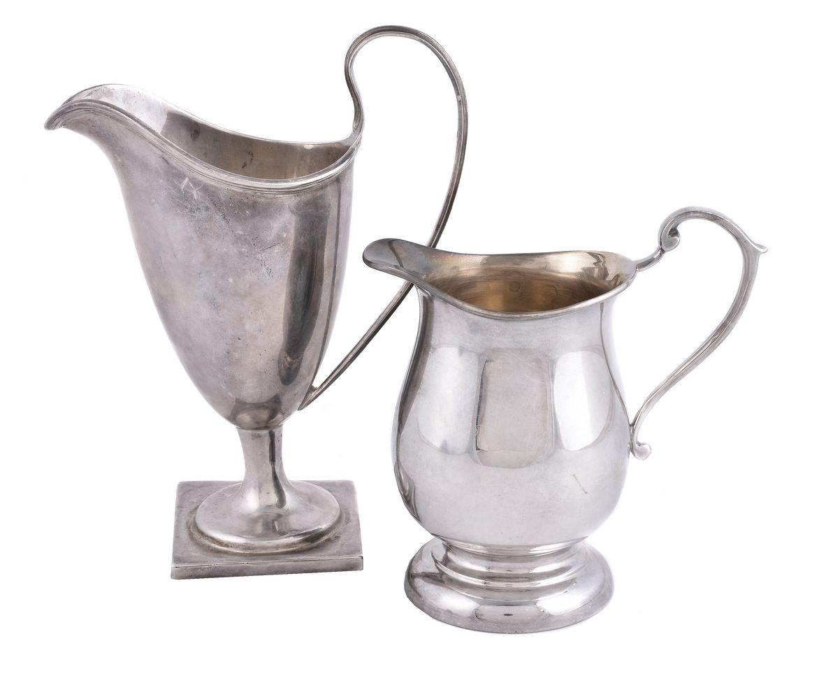 A silver helmet shape cream jug by Florence Warden