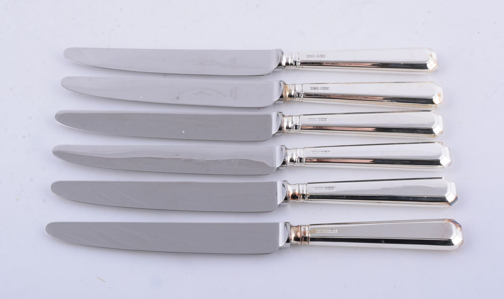 A set of six silver bevelled pattern handled table knives by J. B. Chatterley & Sons Ltd