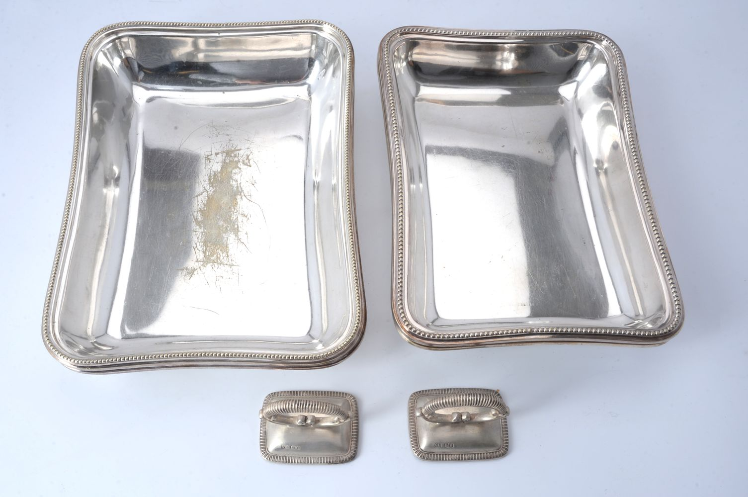 A pair of electro-plated rectangular entree dishes and covers with matched silver handles