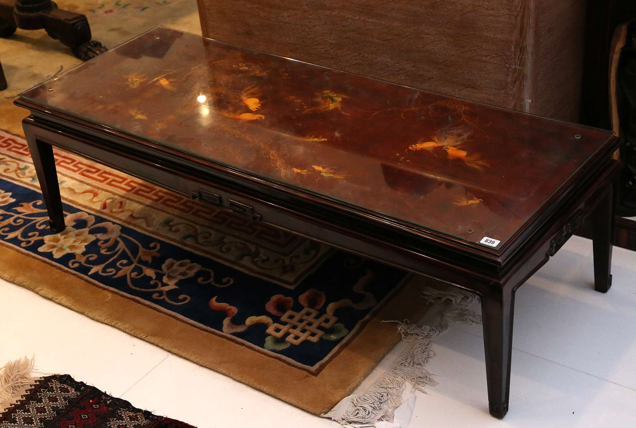 A modern Chinese red lacquered coffee table the rectangular top