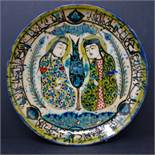 A Persian glazed ceramic plate, made in Tehran, date and makers mark to reverse, depicting a Persian