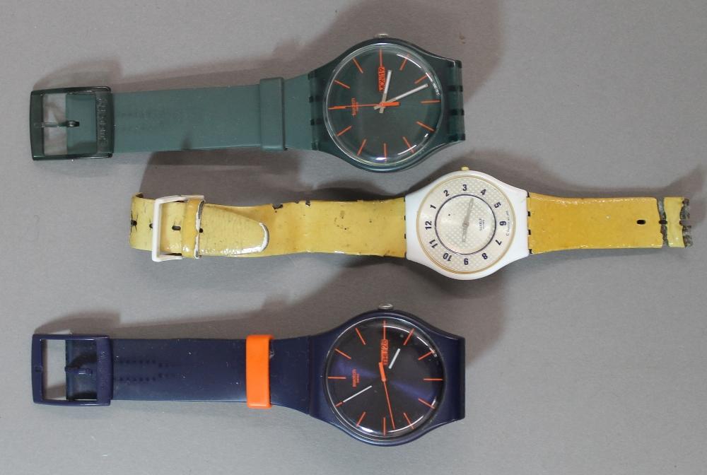 Lot 140 - Three vintage Swatch watches