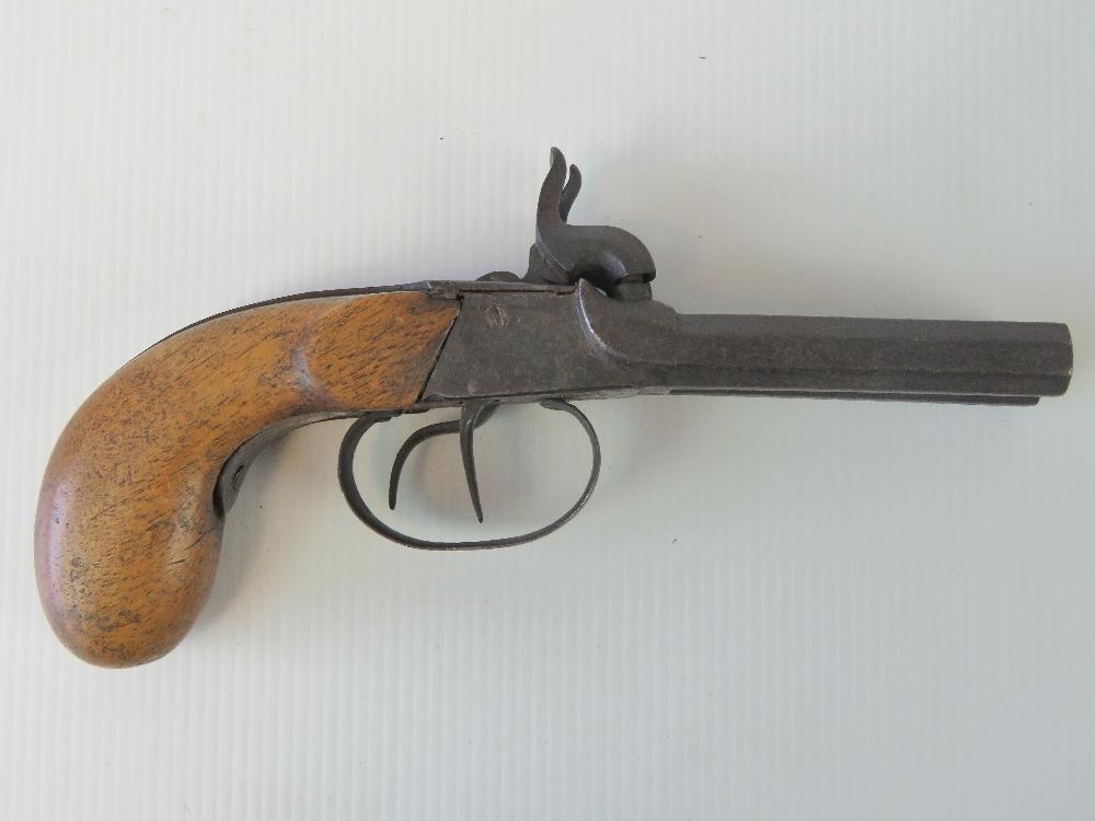 Lot 26 - An antique double barrelled .44 calibre percussion pistol with octagonal barrels.
