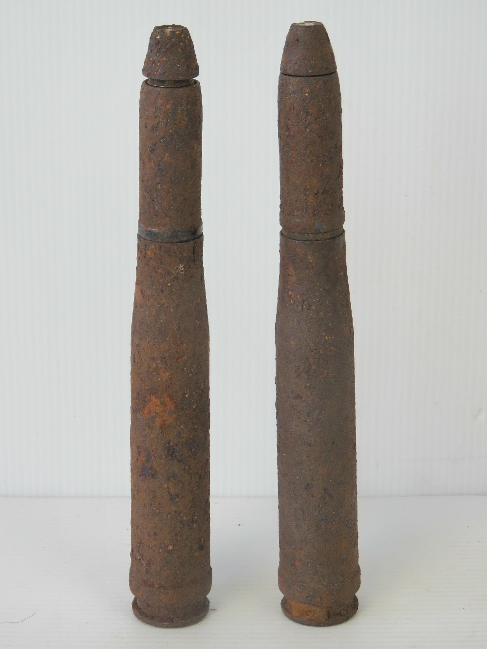 Lot 48 - Two inert German rounds in relic condition, each measuring 20.5cm in length.