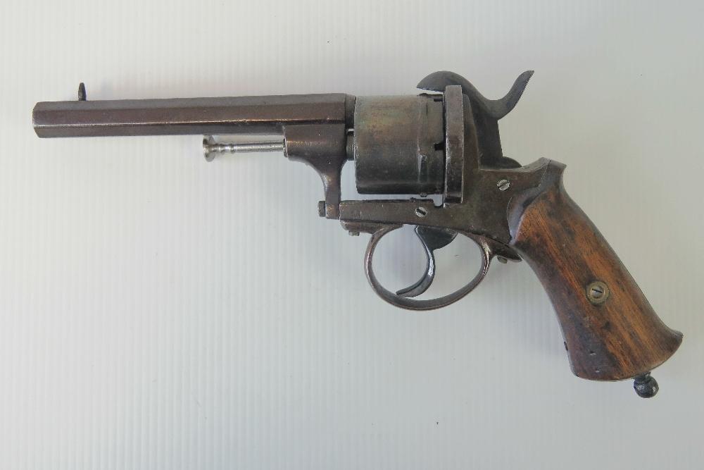 Lot 9 - A 19th century Belgian pinfire 9mm calibre revolver having octagonal barrel and wooden handle.